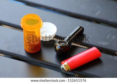 Everything you need for medicinal marijuana including a lighter, pipe, and medicinal marijuana - stock photo