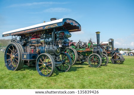 EVESHAM,WORCESTER,ENGLAND - APRIL 13 :A vintage steam traction engine with its owners on display in the show ring at a country fair on April 13 , 2009 in Evesham,England - stock photo