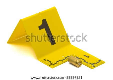Evidence marker with bullet casing on white background - stock photo