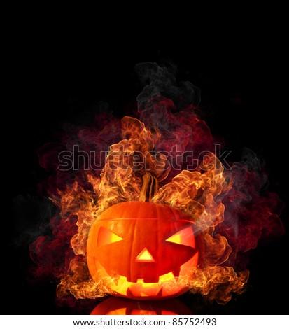 Evil burning halloween pumpkin isolated on black background - stock photo