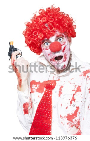 Evil Clown In Blood Stained Business Outfit Holding Cap Gun During A Halloween Robbery On White Background - stock photo