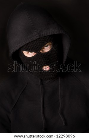 evil criminal wearing balaclava - stock photo