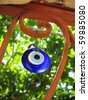 Evil eye - talisman of blue glass. Mediterranean people believed that evil eye keeps evil things away and brings good luck - stock photo