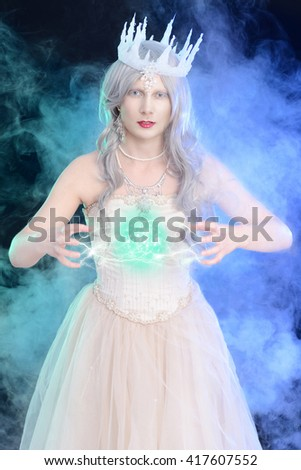 evil ice queen with ball of magic - stock photo
