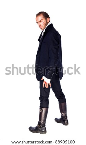 Evil male vampire standing on white background, looking back at camera