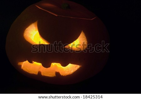 Evil Pumpkin head  with light inside in complete darkness