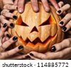 evil pumpkin that are holding, closeup - stock photo
