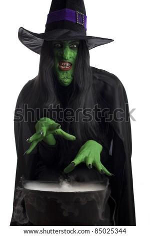 Evil witch casting spells over her misty cauldron, white background. - stock photo