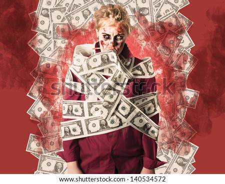 Evil zombie tied up and covered in American one dollar bills when suffering from financial debt. Dead money - stock photo