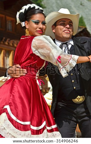 EVOLENE, SWITZERLAND - AUGUST 11: Two mexican dancers from Guadelupe Omexochitl in the CIME mountain culture Festival: August 11, 2015 in Evolene, Switzerland - stock photo