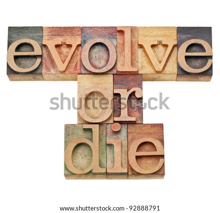 evolve or die -  evolution or adaptation concept -  isolated text in vintage wood letterpress type, stained by color inks
