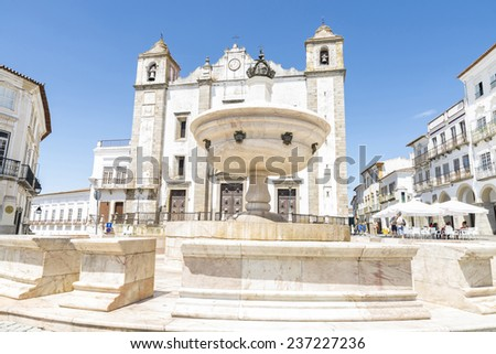 Evora, Portugal - August 21, 2014: Giraldo Square in center of Evora. The square dates from 1570 and features the Renaissance fountain (fonte Henriquina) and the St Anton Church