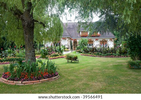 Evron (Mayenne, Pays de la Loire, France) - Exterior of house with garden
