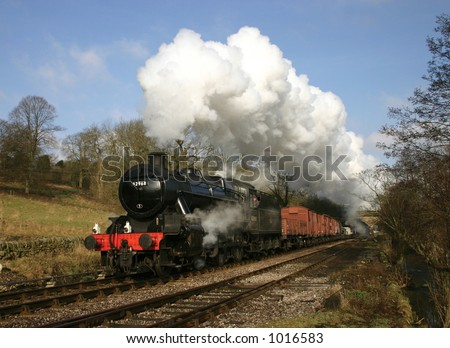 ex London Midland and Scottish Railway locomotive 42968 with a goods train at Haworth, West Yorkshire - stock photo