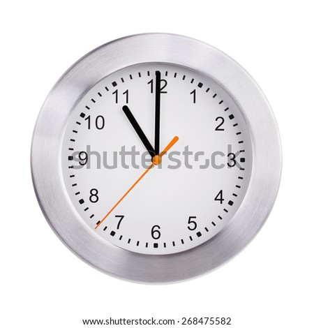 Exactly eleven hours on a big round dial - stock photo