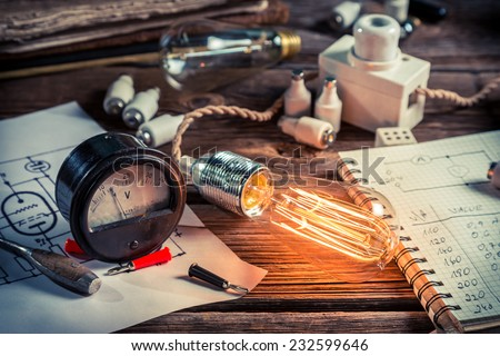 Examination of current and light bulbs in physics laboratory - stock photo