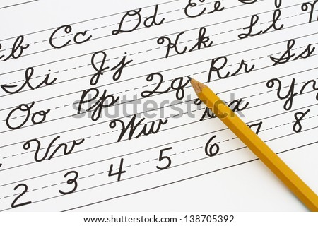 Example of cursive writing with a pencil, Learning cursive writing - stock photo