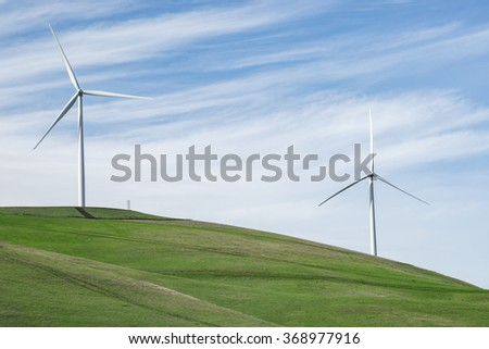 Examples of the modern wind turbines being used to repower the Altamont Wind Resource Area.  Modern replacement turbines should reduce the number of birds killed. - stock photo