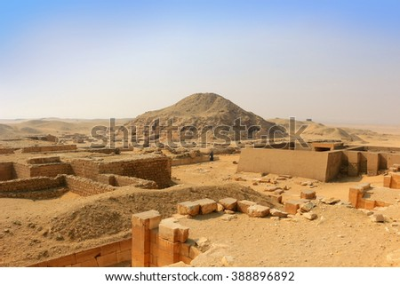 Excavated ruins in Saqqara, Egypt, in the golden sands  - stock photo