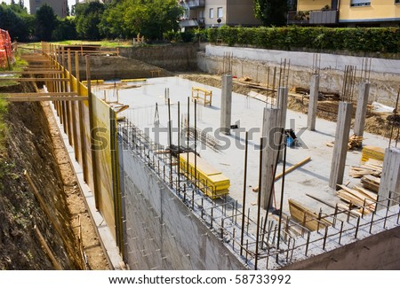 excavation and foundation for the construction of a building - masonry work - stock photo