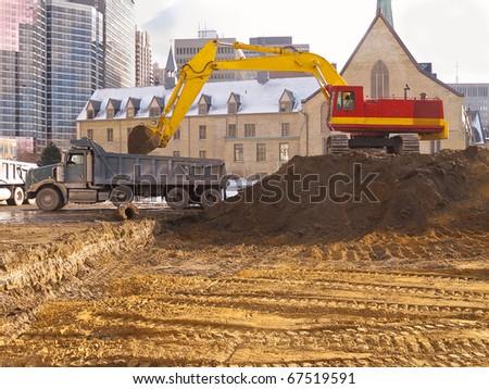 Excavation for new condo development - stock photo