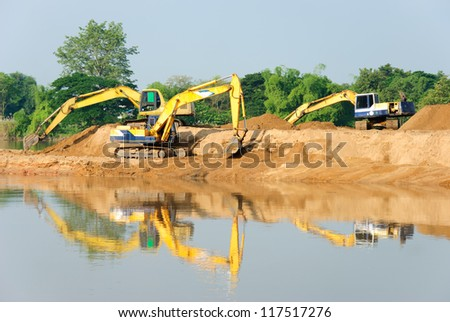 Excavation with a backhoe. - stock photo