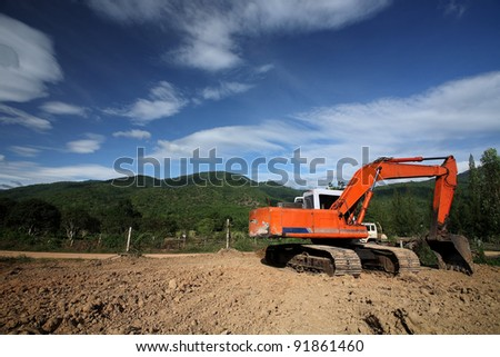 Excavation work on the construction of rural roads - stock photo