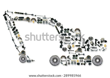 Excavator assembled from new auto, spare parts. Spare parts for shop, aftermarket, OEM. Excavator with spare parts. New spare parts for shop. Many auto spare parts for car. Isolated auto spare parts - stock photo