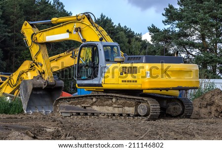 Excavator at a road construction site - stock photo