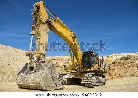 Excavator at Quarry site - stock photo