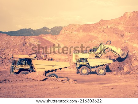 excavator at work in the open-pit mine - industrial machinery digger coal lignite - stock photo