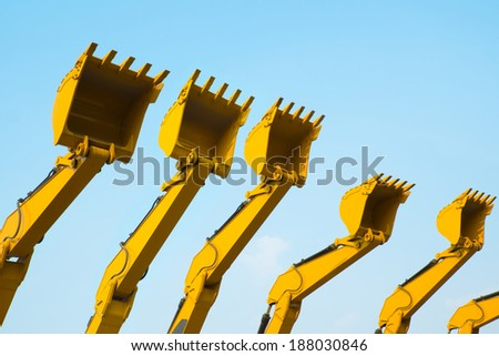 excavator buckets line up ready for construction work - stock photo