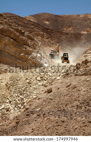 Excavator  building a mountain road