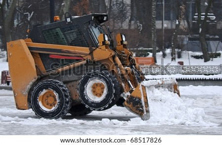 Excavator clears snow on the streets of Kiev Ukraine - stock photo