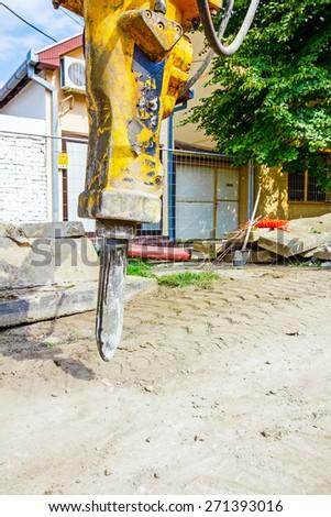 Excavator has attached hydraulic plug-in platform demolition hammer. - stock photo