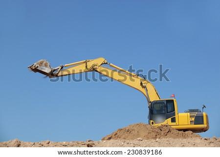 excavator in action  on site - stock photo