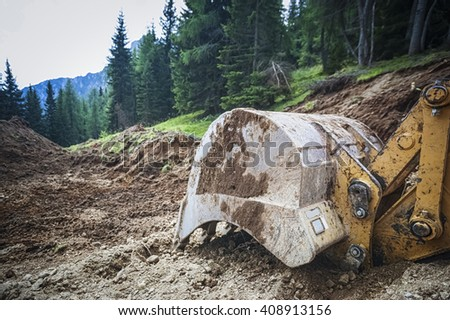 excavator in the nature - stock photo