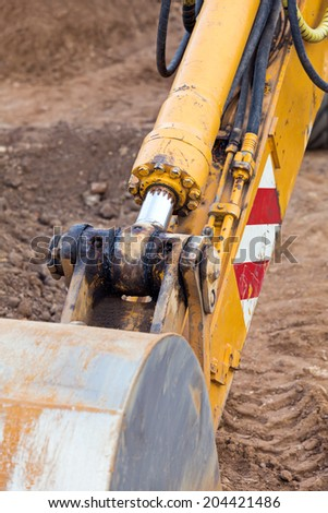 Excavator loader with backhoe standing at construction site - stock photo