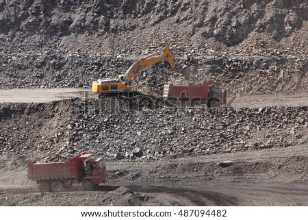 excavator loading ore into the car