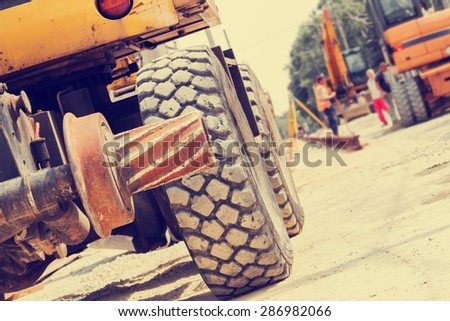Excavator on a construction site. - stock photo
