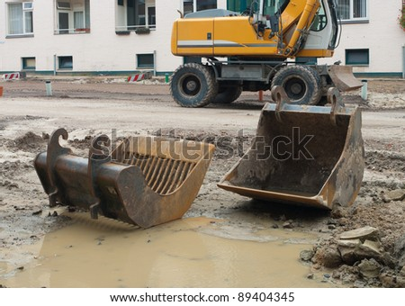 excavator on a construction site - stock photo