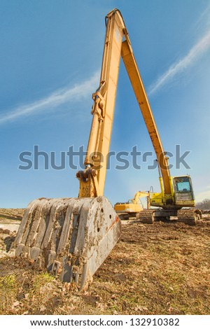 Excavator on a field in mud
