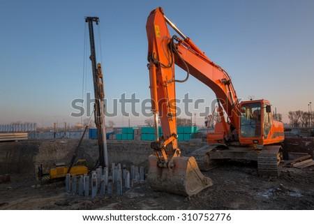 Excavator on new construction site - stock photo