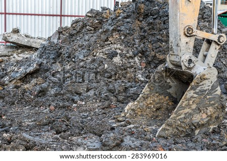 excavator scoop digging on the ground background - stock photo