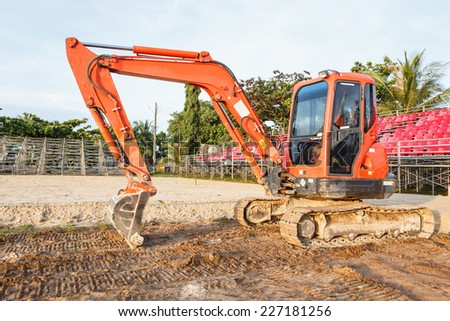 Excavator stand in construction site - stock photo