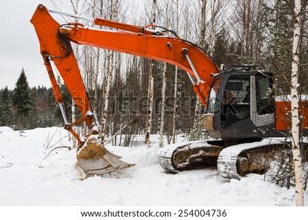 Excavator winter - stock photo