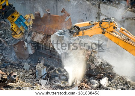Excavator with bucket crush concrete and metal  - stock photo