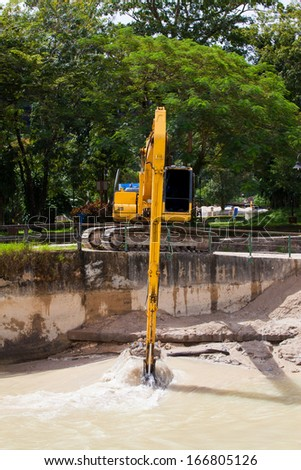 Excavator with metal tracks at construction site. - stock photo