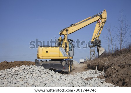 excavator working on a construction site, construction of new streets