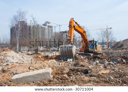 Excavator works in a construction site